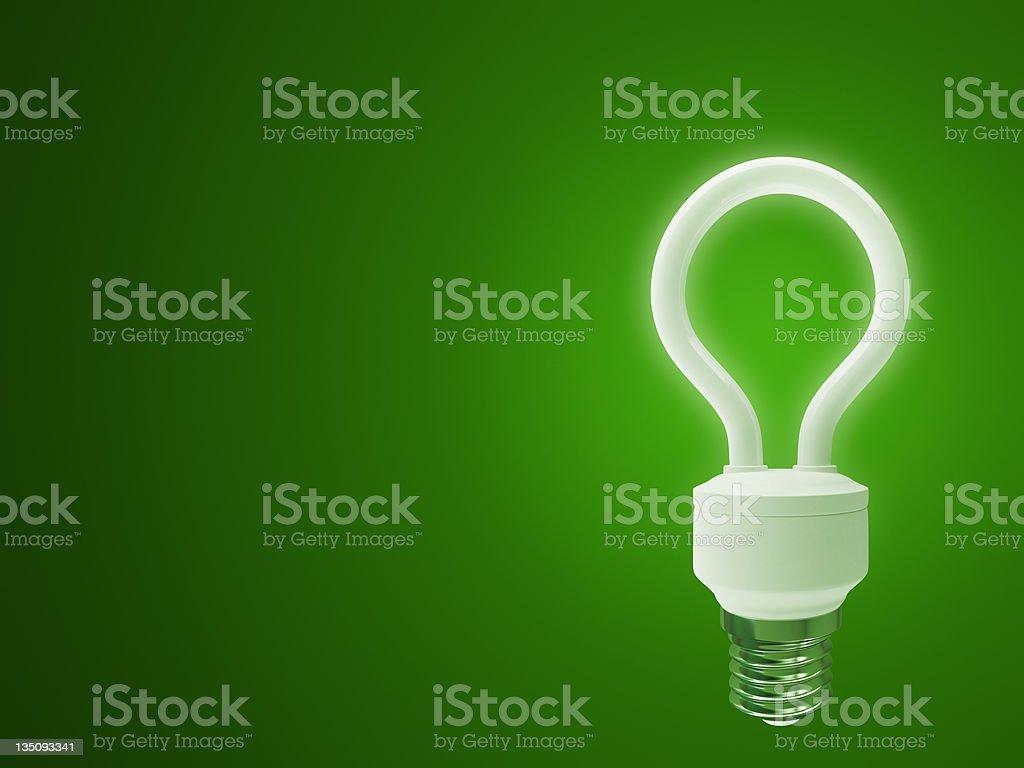 3d energy  saving fluorescent light bulb  on green background royalty-free stock photo