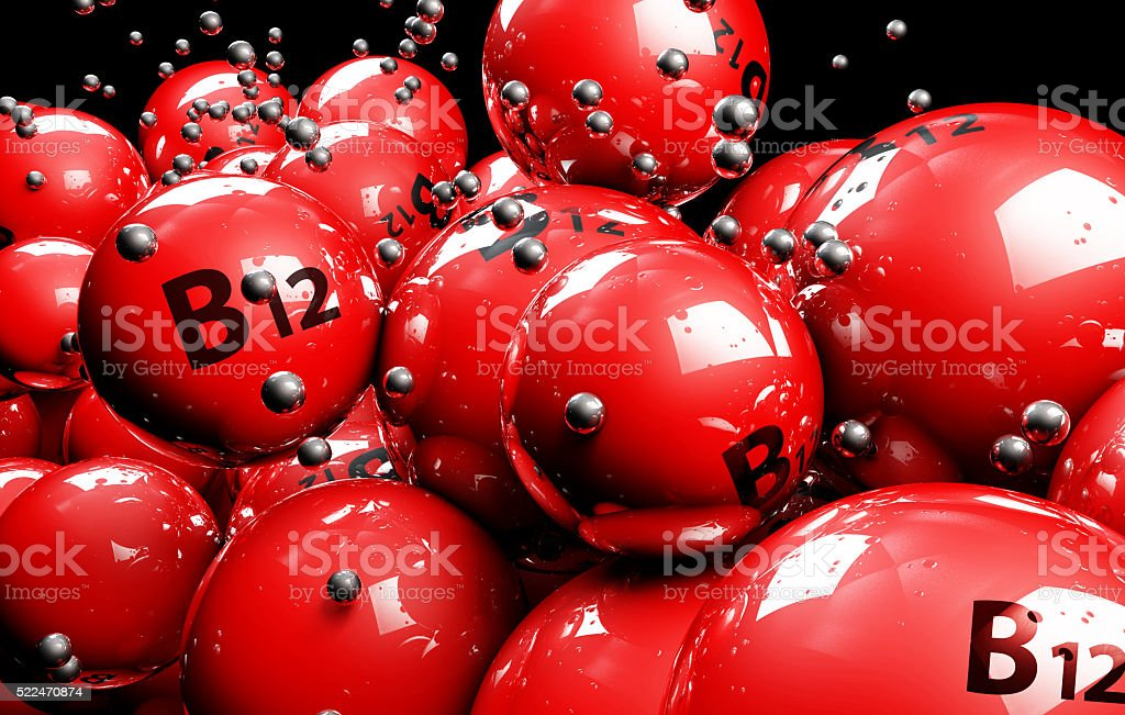 3d multicolor ball Vitamine on a black background stock photo
