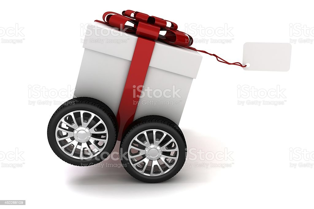 3d present box with red bow on wheels stock photo