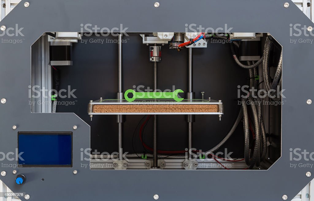 3d printer with bright green filament stock photo