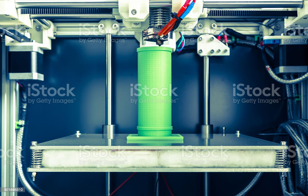 3d printing with light green filament stock photo