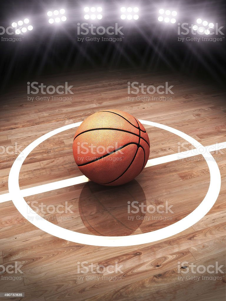 3d rendering of a basketball on a court with stadium lighting stock photo