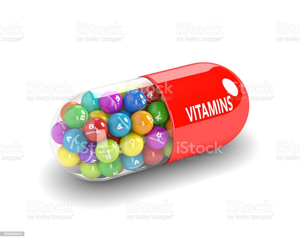 3d rendering of vitamin pill with granules stock photo