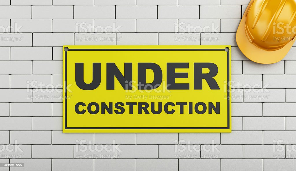 3d Under construction sign on brick wall. stock photo