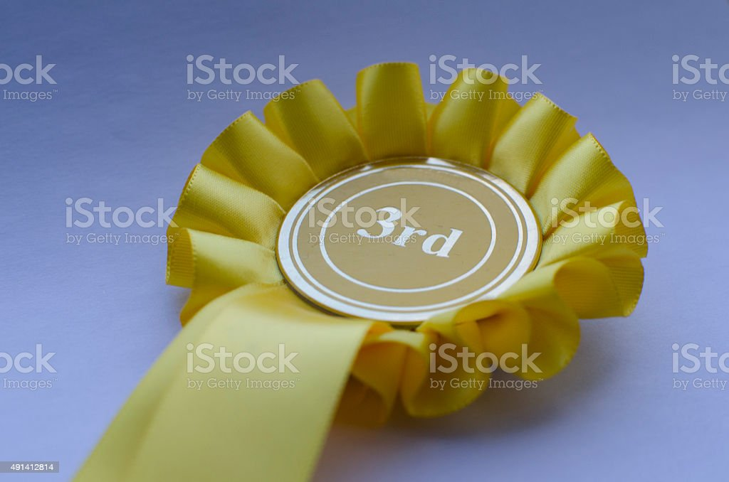 3rd place rosette stock photo