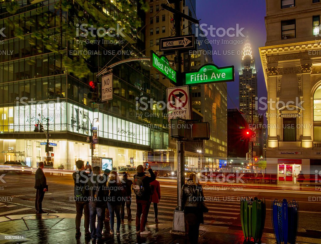 42nd Street and Fifth Avenue at Dusk Showing Chrysler Building stock photo