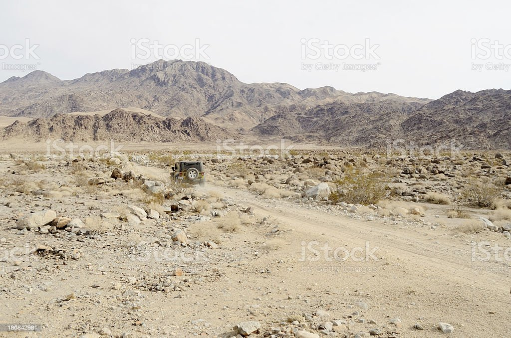 4x4 car driving in the desert stock photo