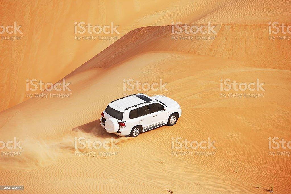 4x4 dune bashing in an Arabian desert stock photo