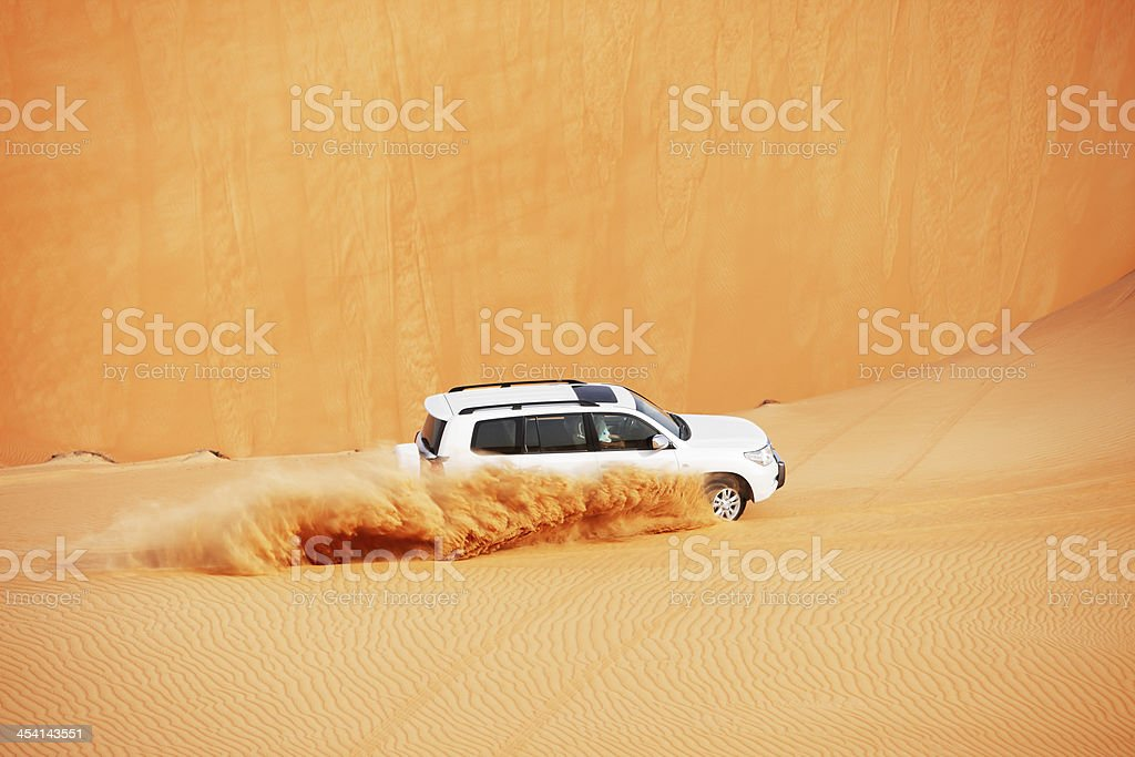 4x4 dune bashing is a popular sport of Arabian desert royalty-free stock photo