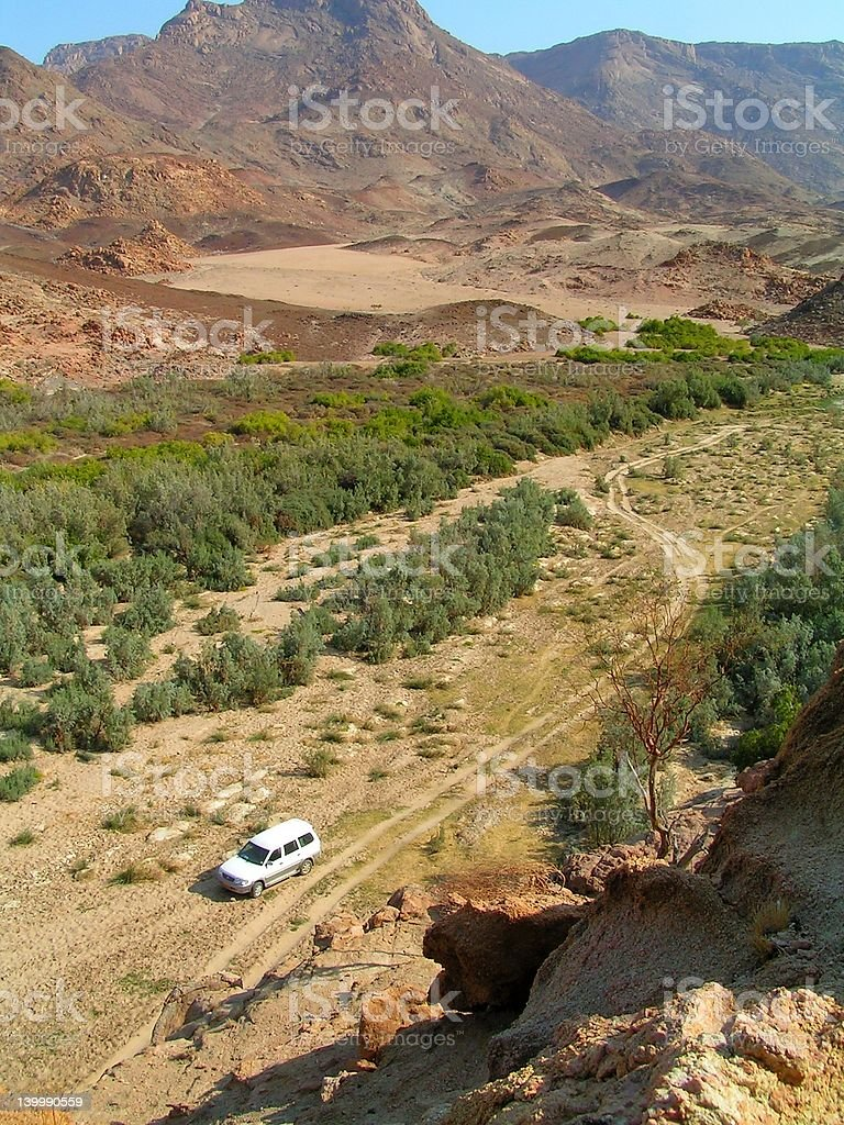 4x4 in a desert valley stock photo