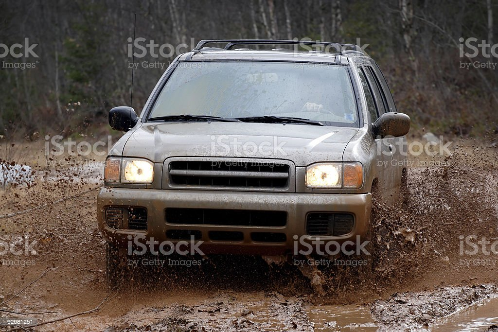 4x4 SUV in the mud splashing offroad royalty-free stock photo