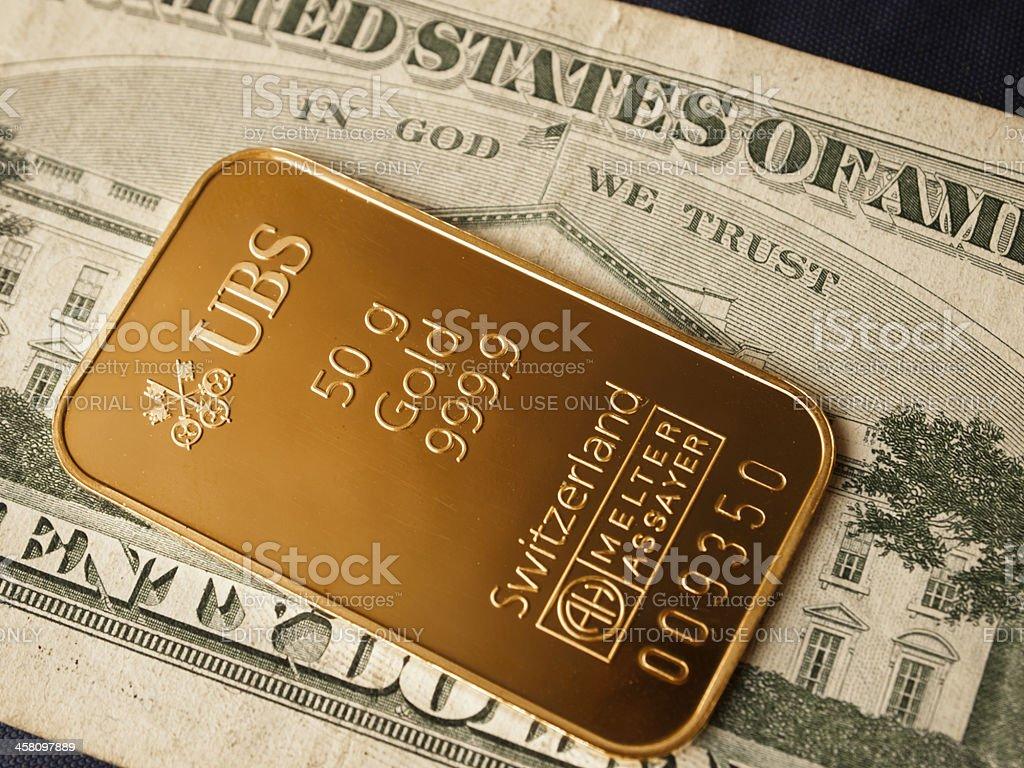 50g gold bar / ingot on a 20 Dollar note. stock photo