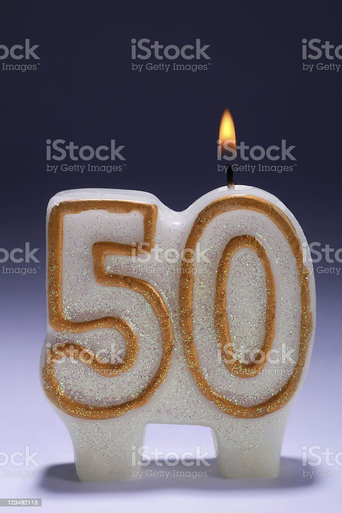 50th anniversary or birthday party candle stock photo