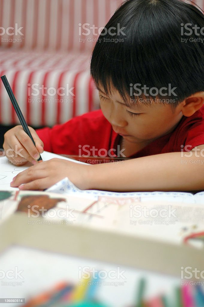 5-year old Chinese boy learning to write royalty-free stock photo