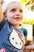 5-year-old blonde girl Hello Kitty T-shirt smiling Japanese