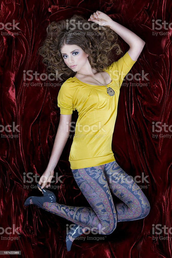 60s Retro Young Woman Fashion Model in Leggings on Velvet royalty-free stock photo