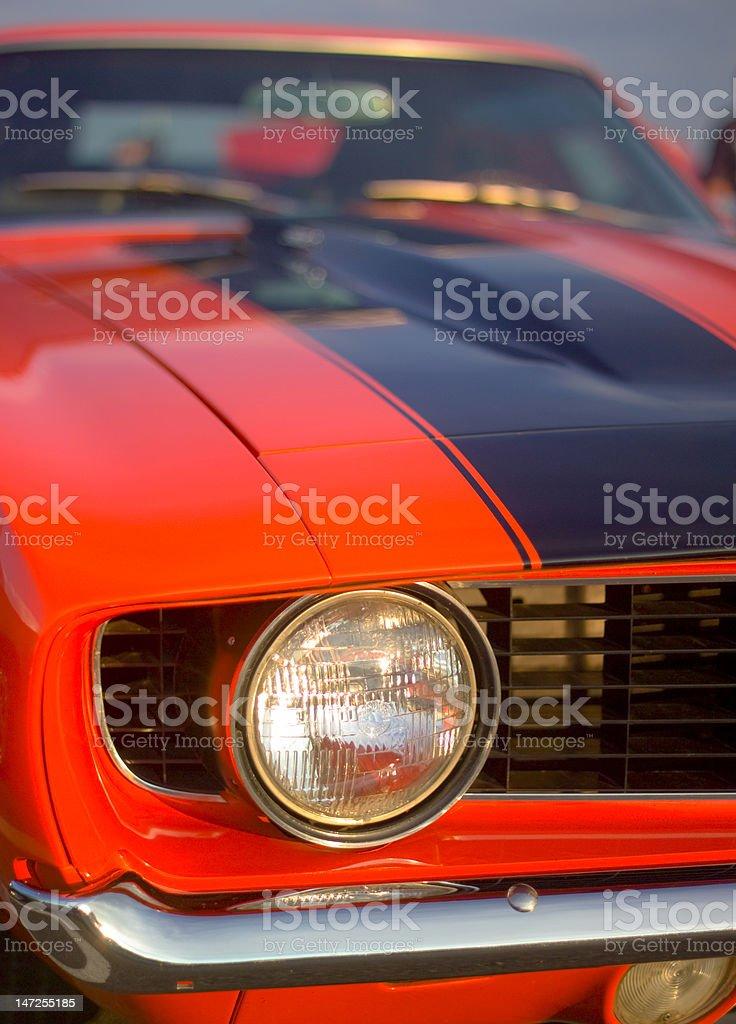 60s sports car headlight. stock photo