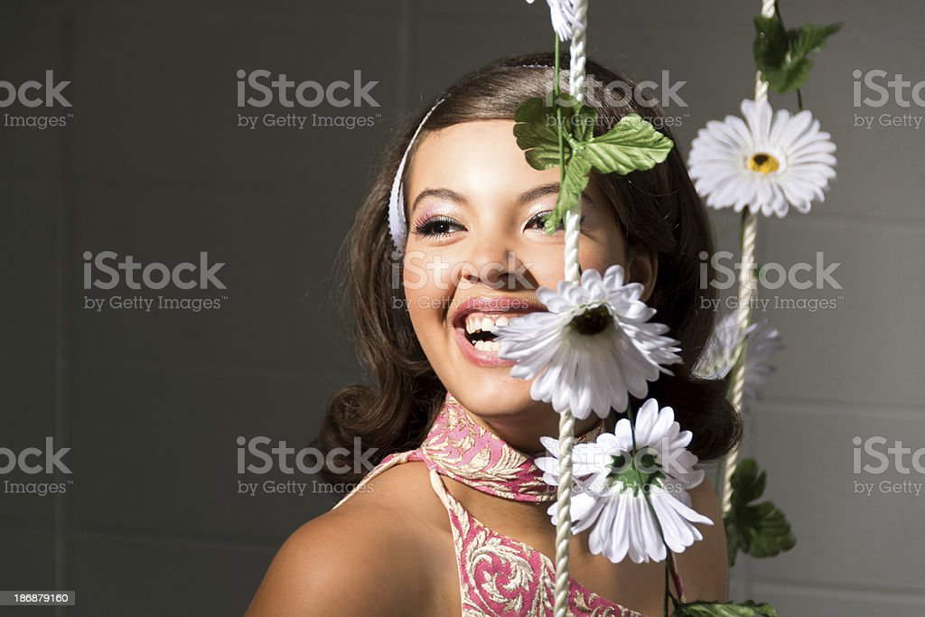 60s styled teen laughing at someone off-camera. royalty-free stock photo