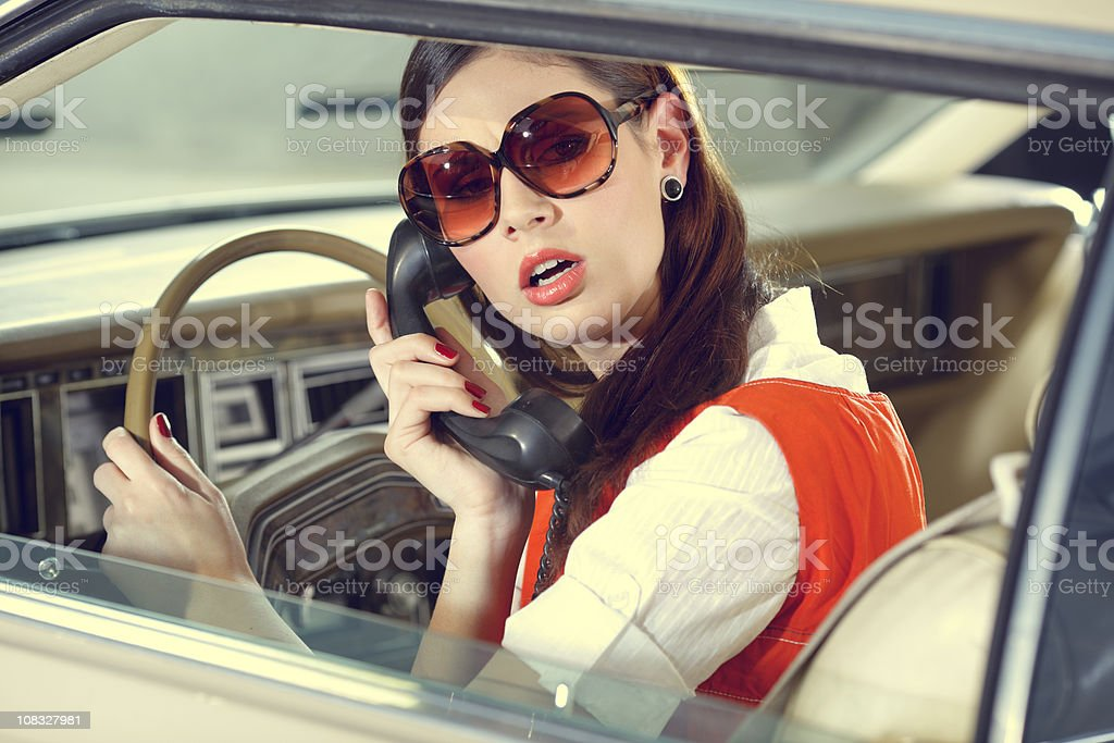 70s girl  in the old American car stock photo