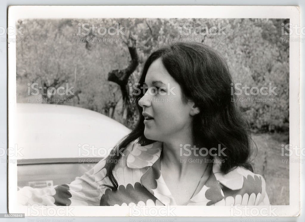 70s young woman outside stock photo