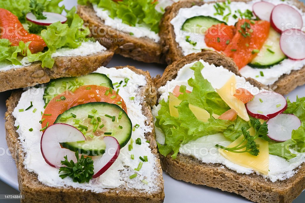 7-Grain bread with cheese ,smoked salmon and vegetables royalty-free stock photo