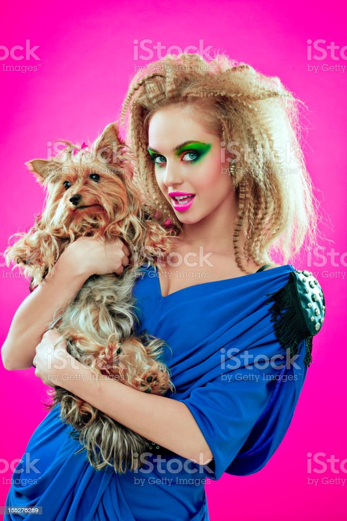 80s style girl with her cute dog royalty-free stock photo