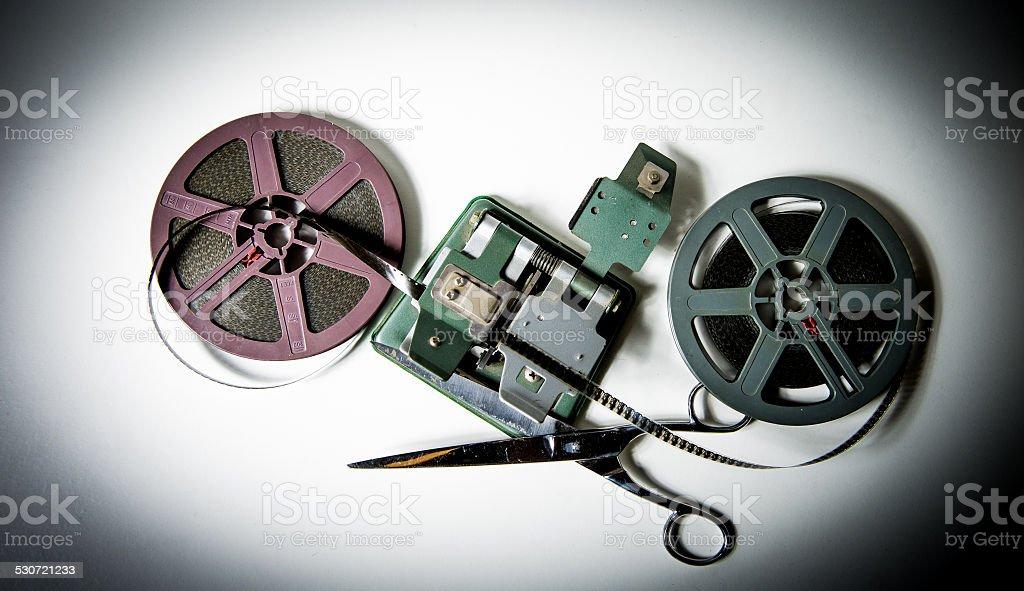 8mm movie reels, film on splicer ans scissors stock photo
