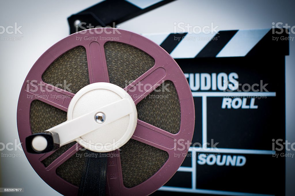 8mm purple reel with out of focus clapper in background stock photo