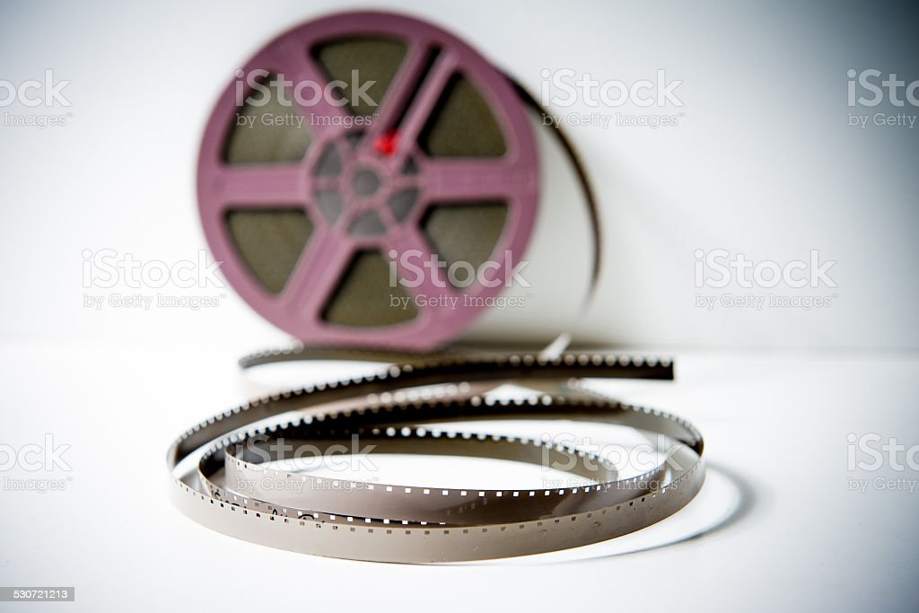 8mm super8 film detail with reel out of focus background stock photo