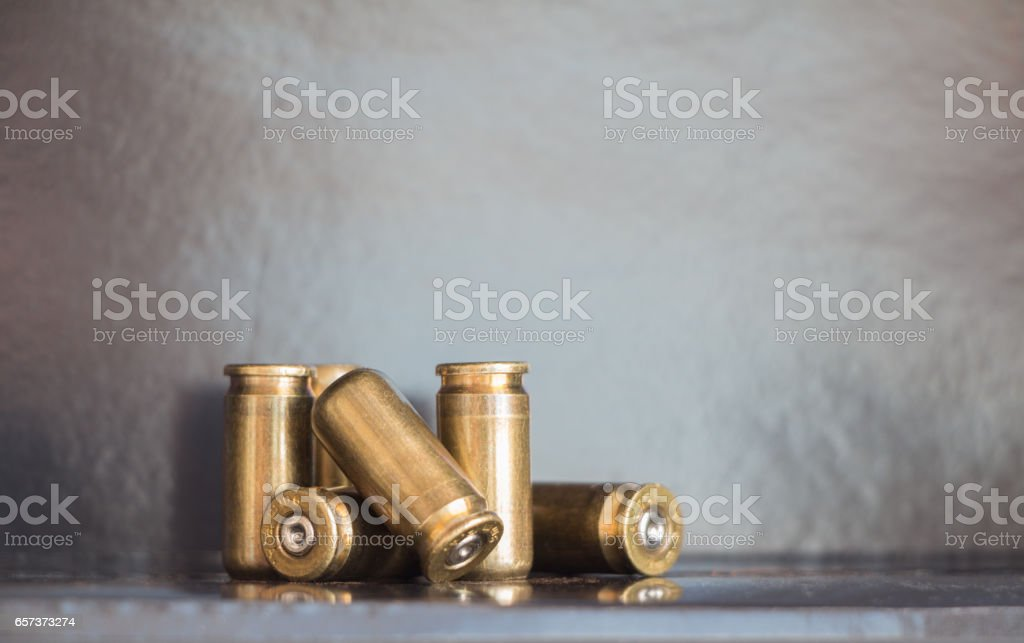 9mm bullet casings on dark background stock photo