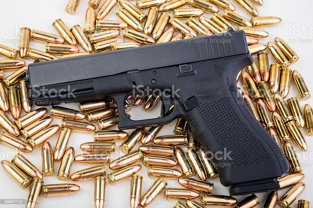 9mm Handgun with ammo stock photo