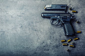 9mm pistol gun and bullets strewn on the table