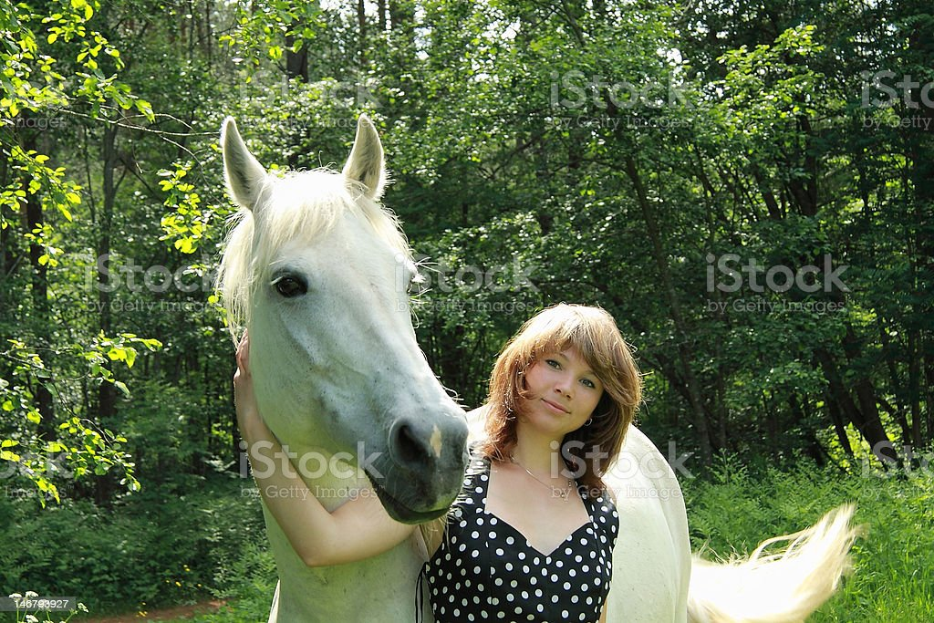 _The girl and a white horse_ royalty-free stock photo