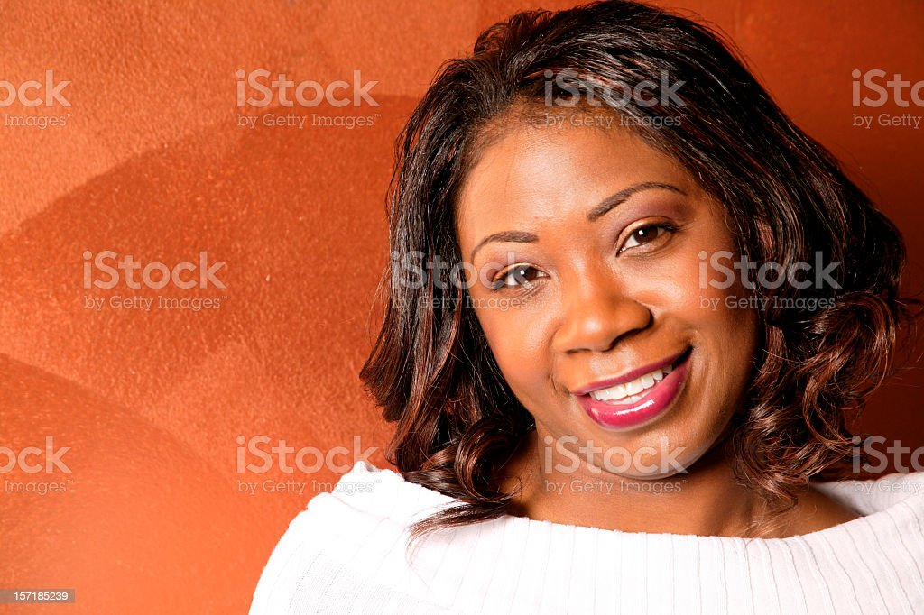 A woman with brown eyes smiling royalty-free stock photo