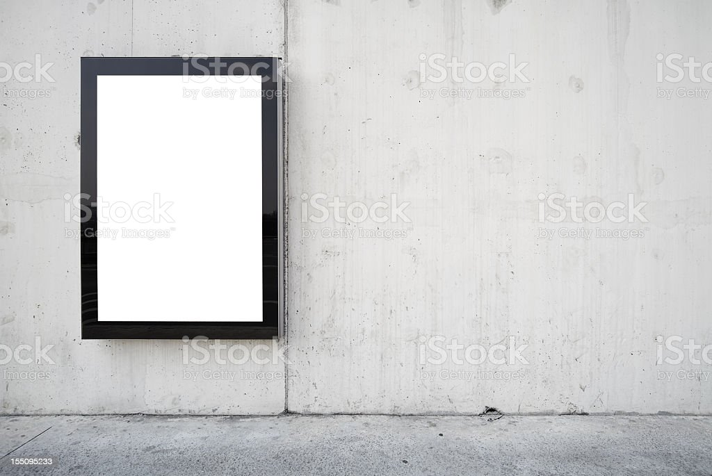 a blank billboard on a wall. stock photo