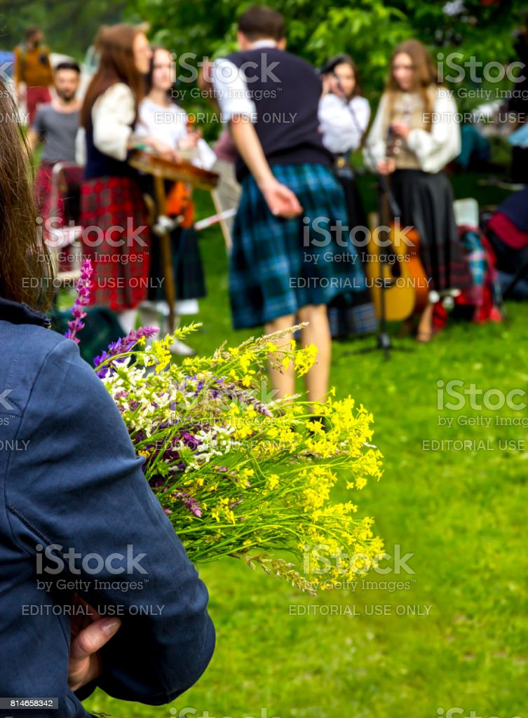 a bouquet of yellow wildflowers in the hands stock photo
