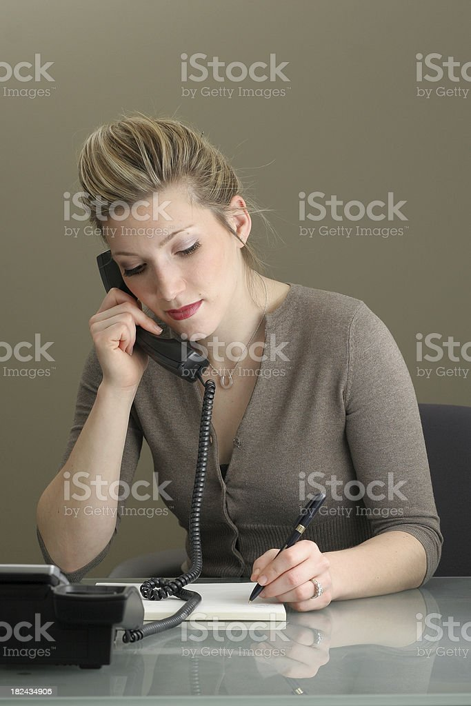 a business women taking a phone message royalty-free stock photo
