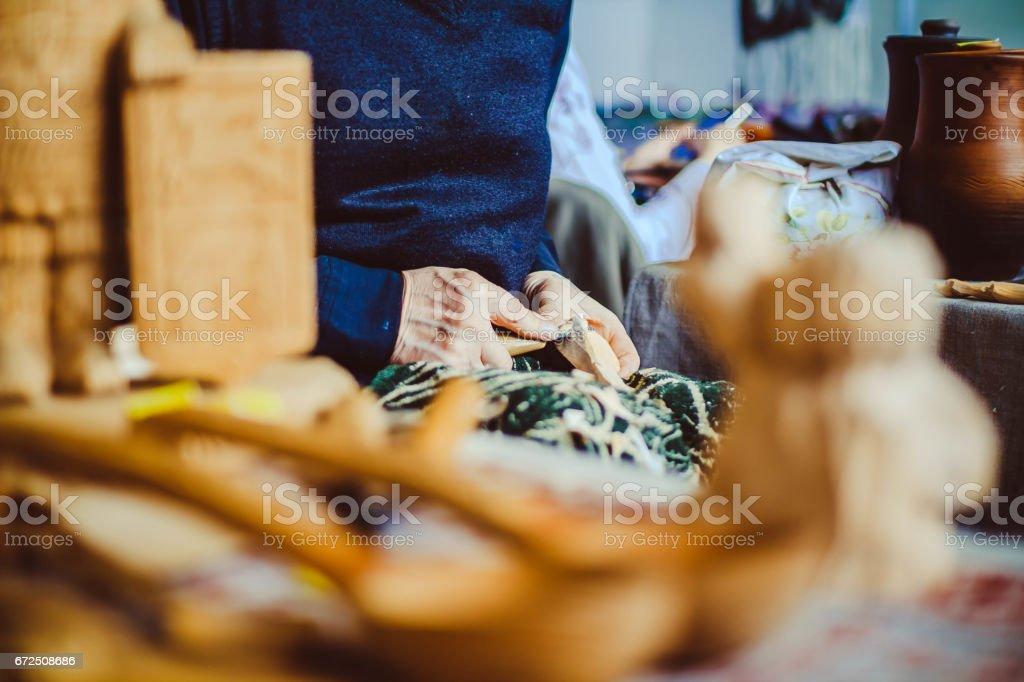 a craftsman carves wood stock photo