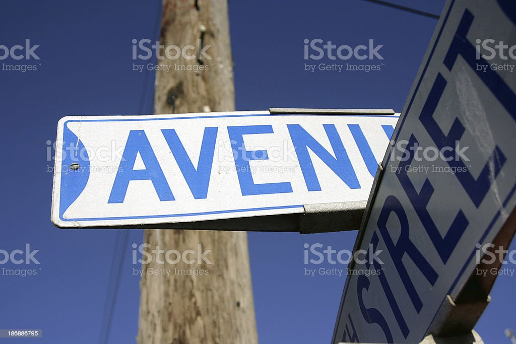 a cross street sign at  intersection 'avenue - street' royalty-free stock photo