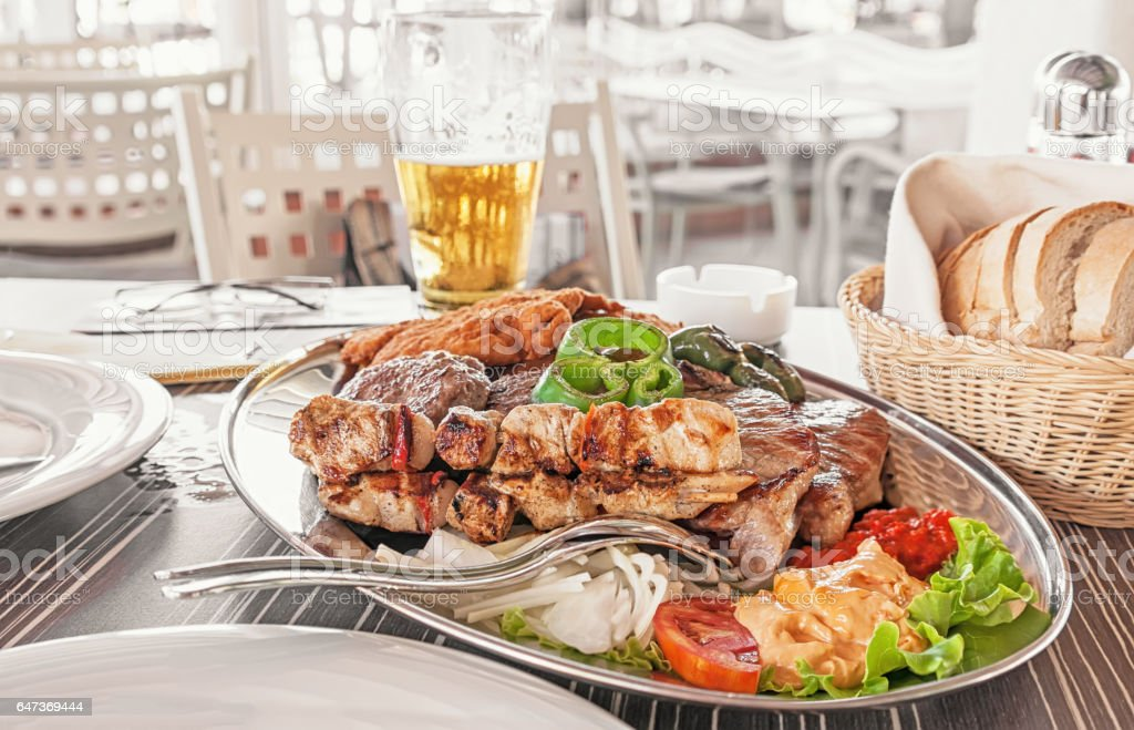 a dish of different meats - beef, pork, chicken, Turkey and grilled vegetables stock photo