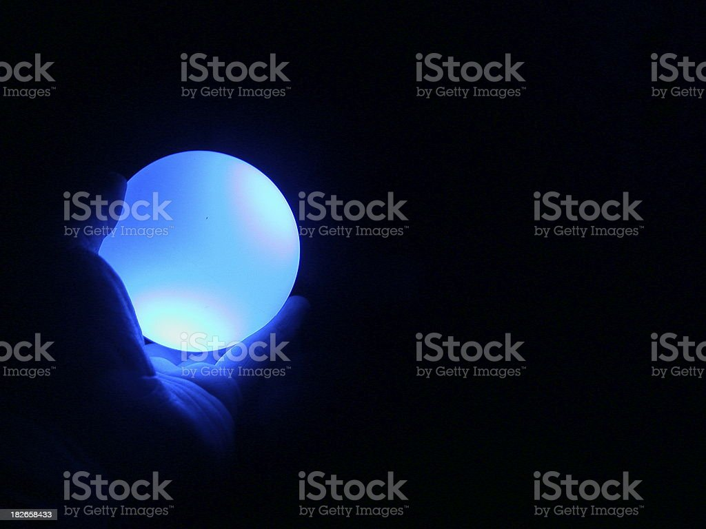 a glowing blue globe - radioactive royalty-free stock photo