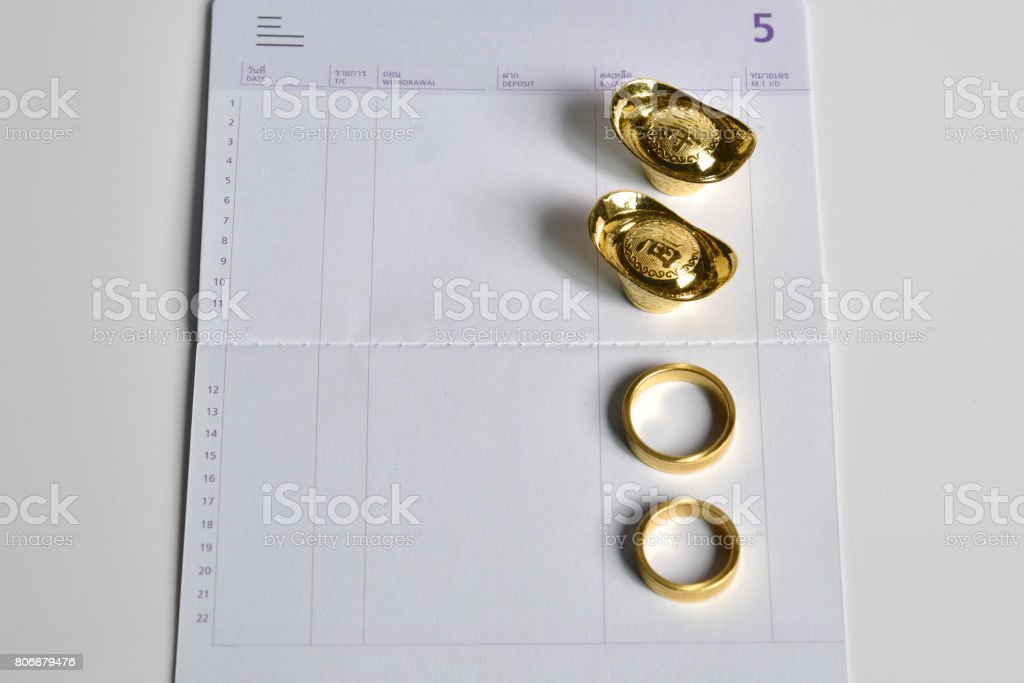 a gold ring and chinese money gold on bank saving account book stock photo