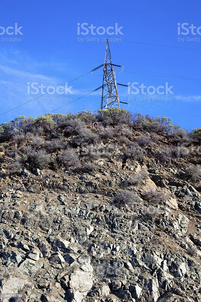 a high voltage transmission tower against a blue sky royalty-free stock photo