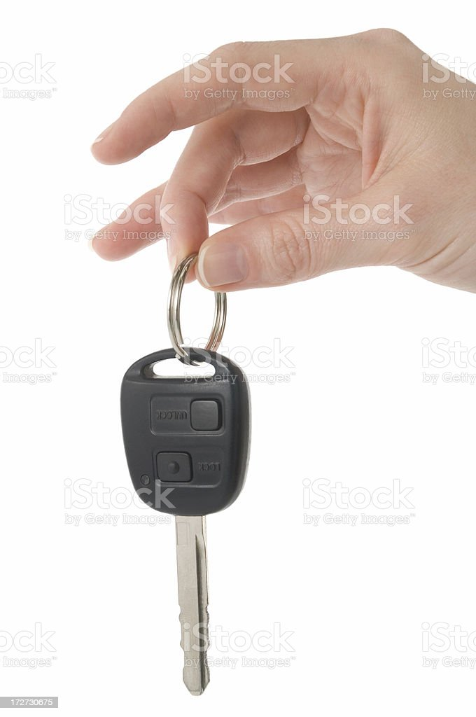 a human hand holding a car key stock photo