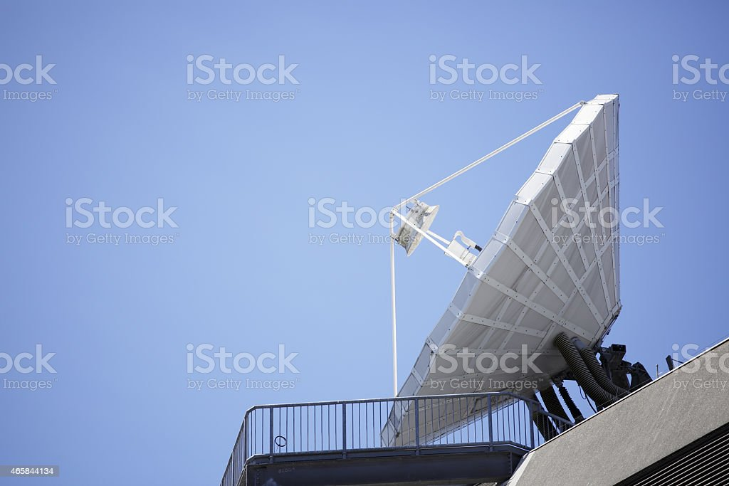 a large telecommunications satellite dish stock photo