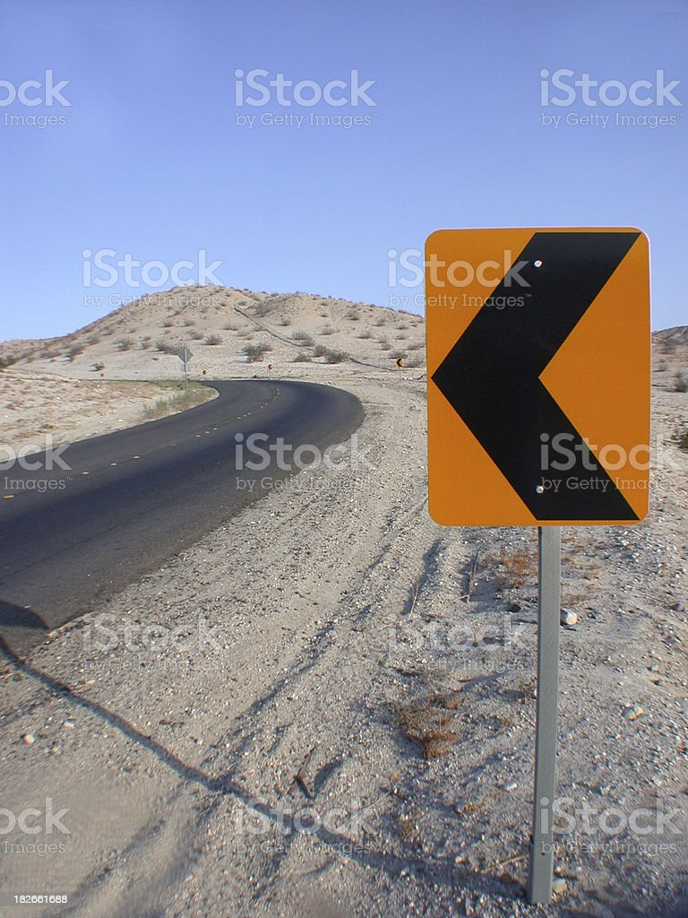 a left sign at uphill roadside stock photo