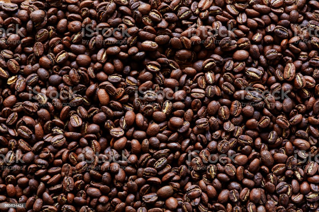 a lot of dark roasted coffee beans stock photo