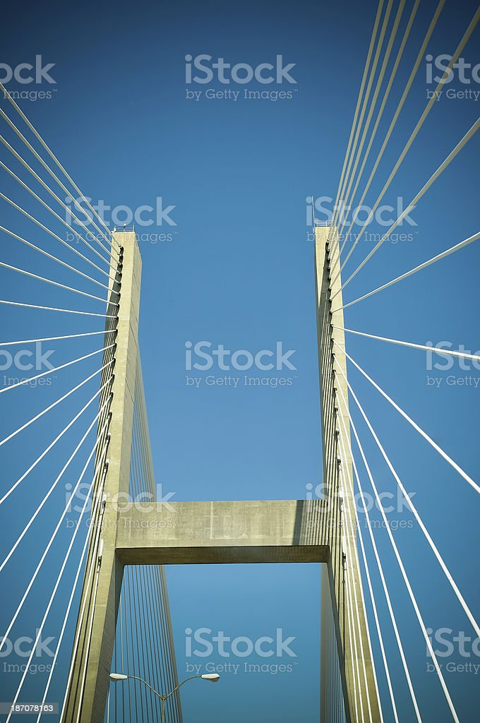 a low angle view of a suspension bridge stock photo