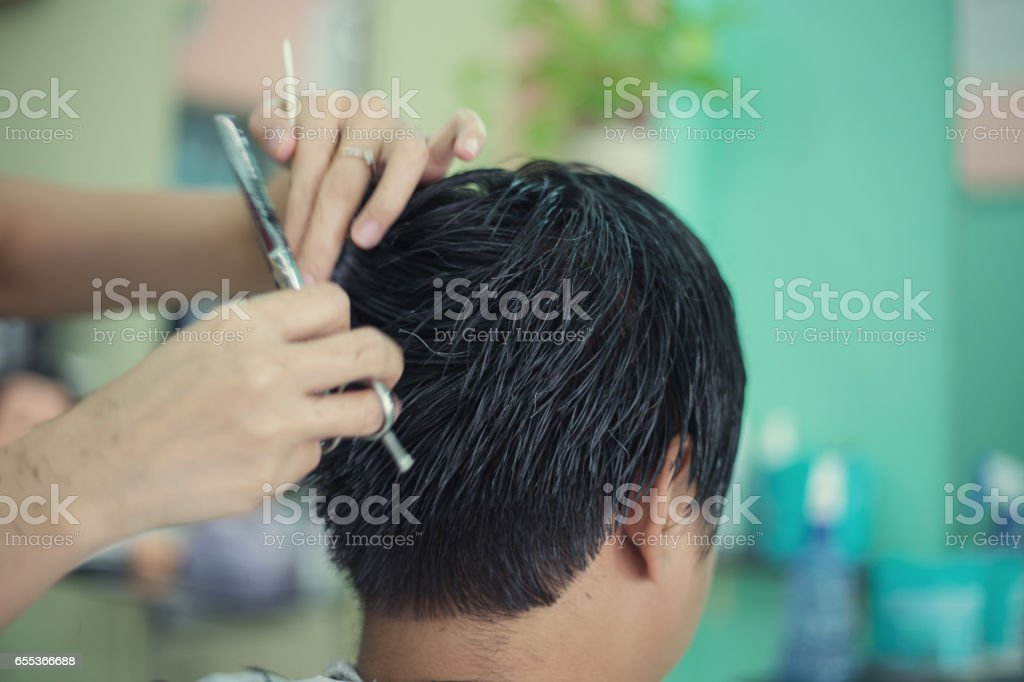 a man cutting hair  at barber stock photo