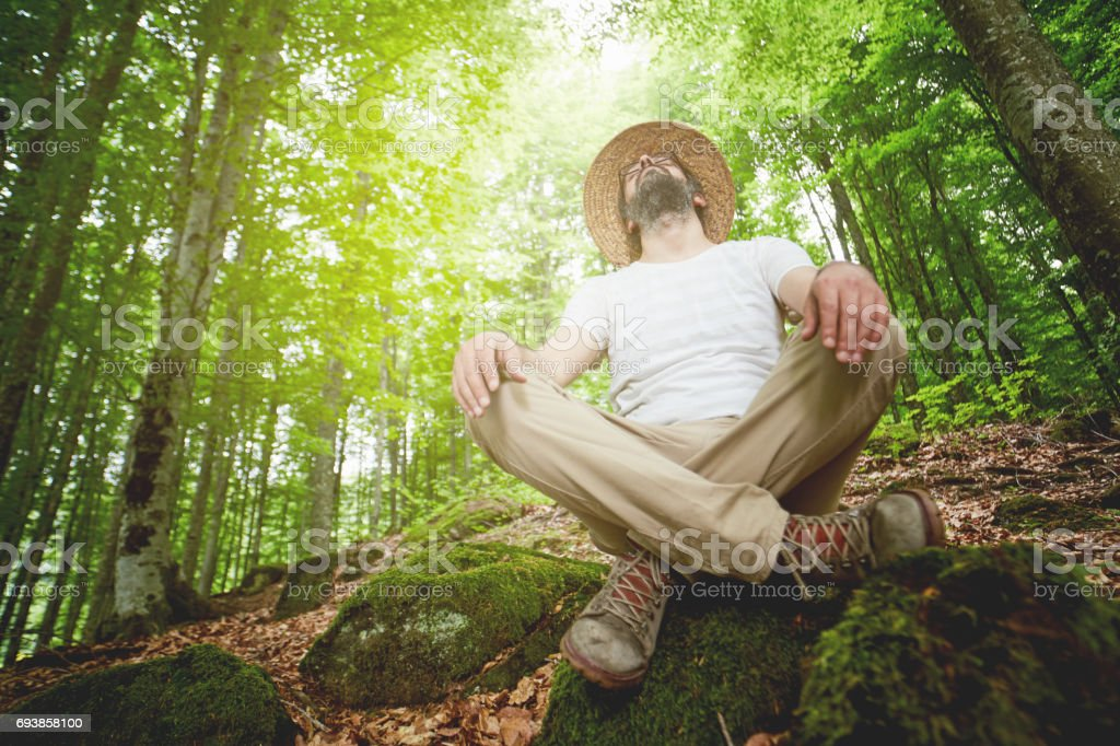 a man to resting and listens to the sounds in nature stock photo